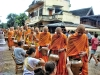 Laos, Sunrise procession. Giving Alms to the Monks